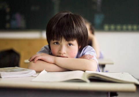 Bored Student in Classroom --- Image by © Michael Prince/Corbis
